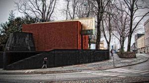 Abelardo Gonzalez arkitektsbyrås förslag. Två röda betongklumpar och en grå malplacerad betongpinne.